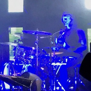 A haunting Clark Baechle behind The Faint's drum kit….