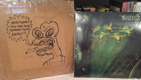 Bloodcow's new album alongside the art it came in.