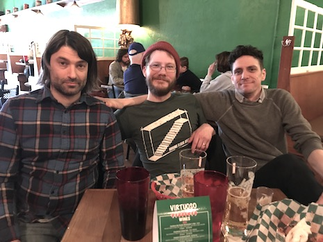 Members of Little Brazil talked about the new record over slices at  Virtuoso Pizza in Benson. From left are Shawn Cox, Landon Hedges and Danny  Maxwell.