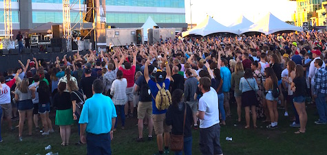 The crowd with hands in the air, as directed by Vince Staples during Saturday's Maha Music Festival.
