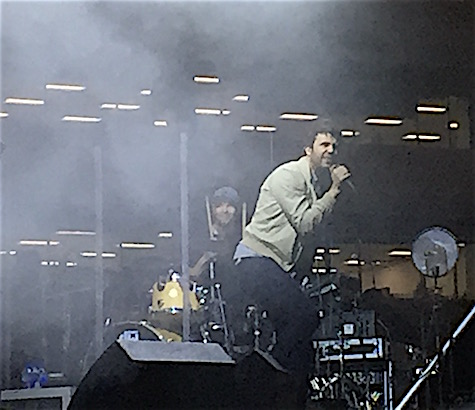 Passion Pit peering through the smoky haze.