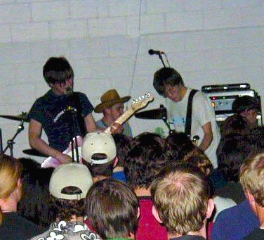 Desaparecidos' 2001 stage debut at the Holy Name High School fieldhouse.