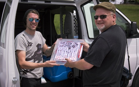 "Tim Guthrie, right, receives his copy of the Flaming Lips' ""blood vinyl"" from Jake."