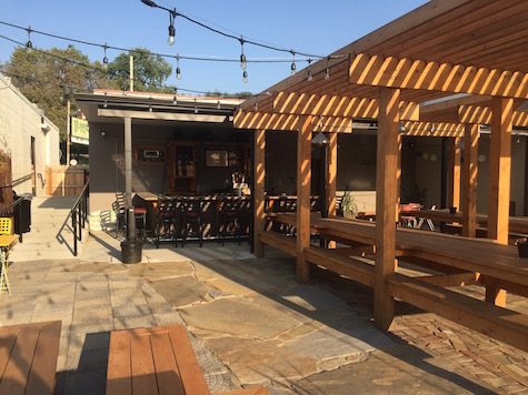 O'Leaver's new patio / beer garden, looking from the back benches toward the new bar and patio entrance. The door from inside O'Leaver's that leads to the patio is on the far left.