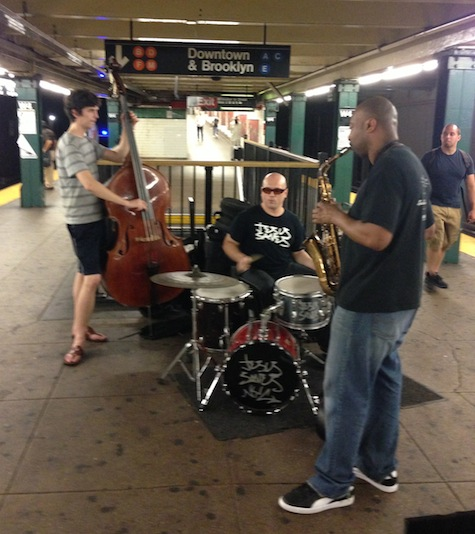 A jazz trio hustling for tips at the West 4th St. subway station in lower Manhattan.
